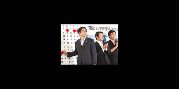 Défait, Abe s'accroche au pouvoir - La Libre