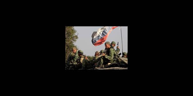 Le retrait des troupes russes se fait attendre - La Libre