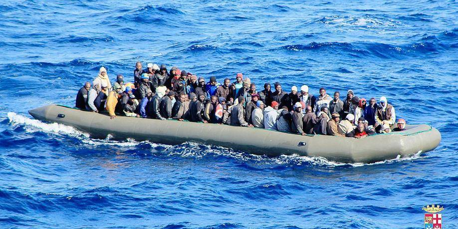 """One of six makeshift boats filled with migrants which was spotted by an Italian Navy ship, in the Mediterranean sea near Lampedusa, on February 5, 2014. The number of refugees landing in Italy rose tenfold in January, the country's deputy interior minister said on February 4, complaining of an """"incessant and massive influx of migrants"""". About 1,000 refugees over six makeshift boats were spotted off the island of Lampedusa (south) on February 5 in the morning, by ships and helicopters of the Italian Navy. In early afternoon, the Italian Military Navy reported relief operations carried out on two of the six dinghies. AFP PHOTO / ITALIAN NAVY == RESTRICTED TO EDITORIAL USE - MANDATORY CREDIT """"AFP PHOTO / ITALIAN NAVY"""" - NO MARKETING NO ADVERTISING CAMPAIGNS - DISTRIBUTED AS A SERVICE TO CLIENTS =="""