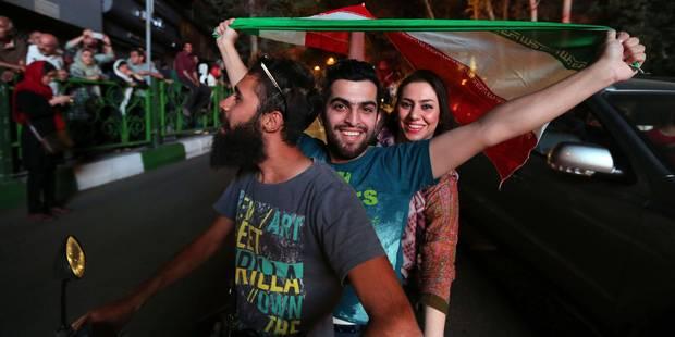 """Les Iraniens, """"heureux"""", célèbrent l'accord nucléaire à Téhéran (PHOTOS) - La Libre"""