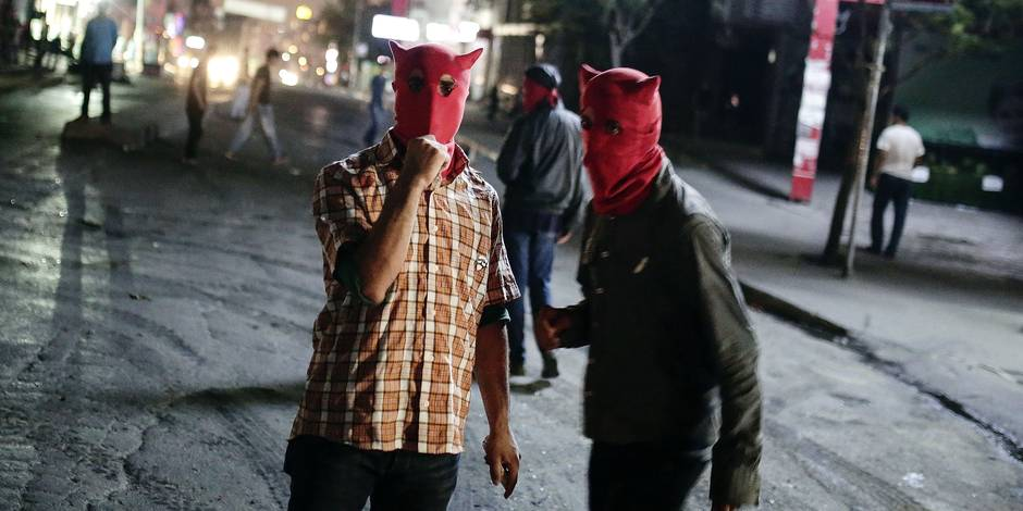 Masked left-wing protesters gesture during minor clashes between police and people protesting Turkey's operations against Kurdish militants in Istanbul, Wednesday, Aug. 19, 2015. There has been a sharp escalation of violence between Turkey's security forces and the Kurdistan Workers' Party, or PKK, along with the collapse of a two-year peace process with the rebels. Dozens of people, mostly Turkish soldiers, have died since July in the renewed violence. (AP Photo/Cagdas Erdogan) TURKEY OUT