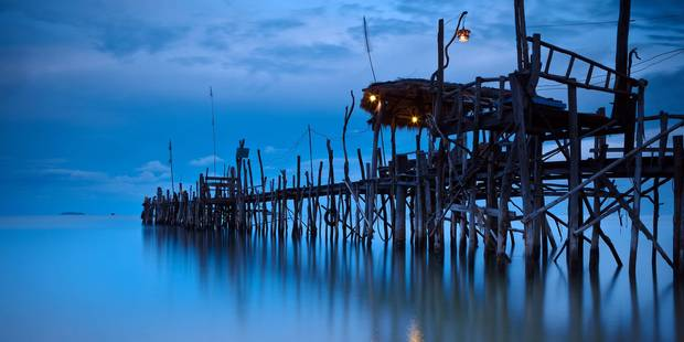 A Wooden Pier With Lights On It At Night; Iceland Reporters / Design Pics
