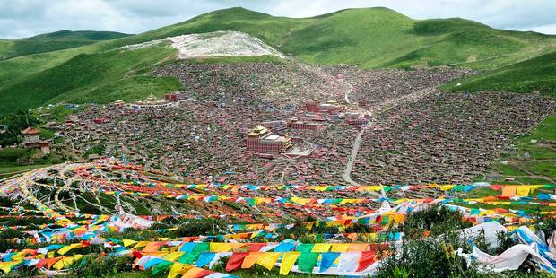 ***EXCLUSIVE*** LARUNG GAR, TIBET - UNDATED: The sprawling hillside settlement of Larung Gar, home to Serthar Buddhist Institute, in the traditional Tibetan region of Kham. THOUSANDS of tiny homes sprawl up a mountainside forming one of the world's largest Buddhist Institutes. The remote settlement in the Larung Valley, Serthar County of Garze Tibetan Autonomous Prefecture, China, found at an elevation of around 12,500ft, is home to over 40,000 monks, nuns and buddhist students. Located in a valley, the town allegedly sprung up from a handful of settlers into the sprawling town that now occupies vast areas of hilly terrain. At the focal point is a giant monastery - with a huge wall separating the monks from the nuns. The homes are predominantly made out of wood. Each one is built so close to the next that they all begin to merge into rows of homes. But the one to three roomed swellings do not have their own toilets - instead communal ones have been built for the 40,000 plus residents. PHOTOGRAPH BY Shinya Itahana / Barcroft India UK Office, London. T +44 845 370 2233 W www.barcroftmedia.com USA Office, New York City. T +1 212 796 2458 W www.barcroftusa.com Indian Office, Delhi. T +91 11 4053 2429 W www.barcroftindia.com Reporters / Barcroft *** Local Caption *** 01488938