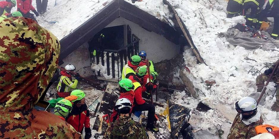 "Italian Mountain Rescue Corps ""Corpo Nazionale Soccorso Alpino e Speleologico"" Soccorso Alpino volunteers and rescuers work in the area of the avalanche-struck Hotel Rigopiano, near Farindola, central Italy, Sunday, Jan. 22, 2017. Rescue crews are considering whether to start using heavy equipment to speed up the search for 23 people still buried under the ruins of a central Italy hotel crushed by an avalanche. (Corpo Nazionale Soccorso Alpino e Speleologico/ANSA via AP)"