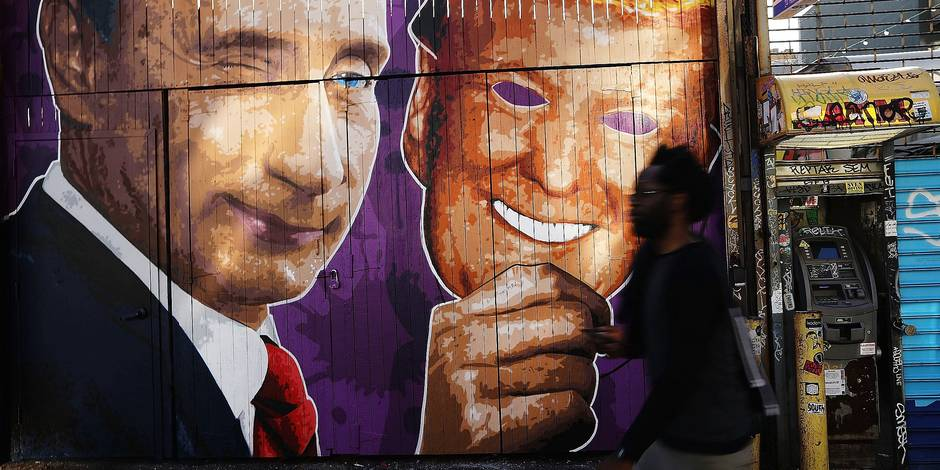 NEW YORK, NY - FEBRUARY 25: A mural depicting a winking Vladimir Putin taking off his Donald Trump mask is painted on a storefront outside of the Levee bar in Brooklyn on February 25, 2017 in New York City. The mural, painted by Damien Mitchell, sits in the popular Williamsburg neighborhood and has become a minor attraction with people photographing and taking selfies beside it. Spencer Platt/Getty Images/AFP == FOR NEWSPAPERS, INTERNET, TELCOS & TELEVISION USE ONLY ==