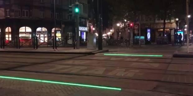 Des bandes lumineuses au sol pour guider les piétons distraits par leur smartphone - La Libre