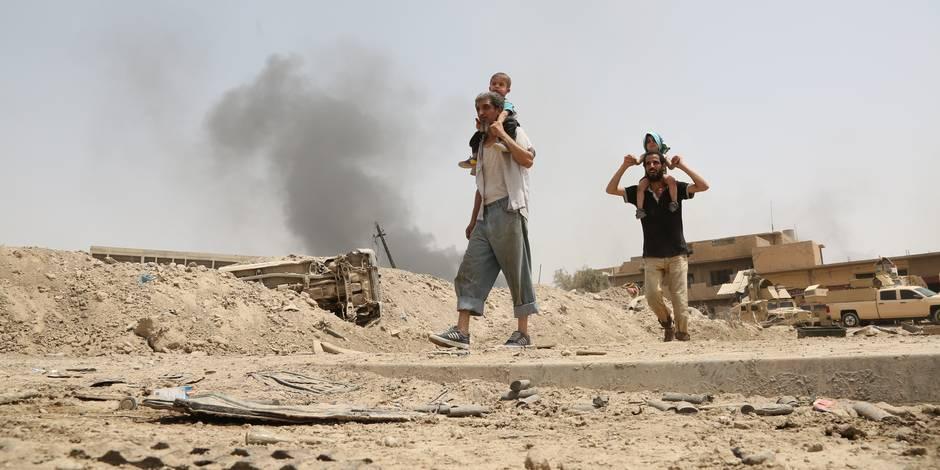 Les djihadistes pressaient les hommes de Mossoul de s'enrôler: un père et son fils témoignent de l'enfer