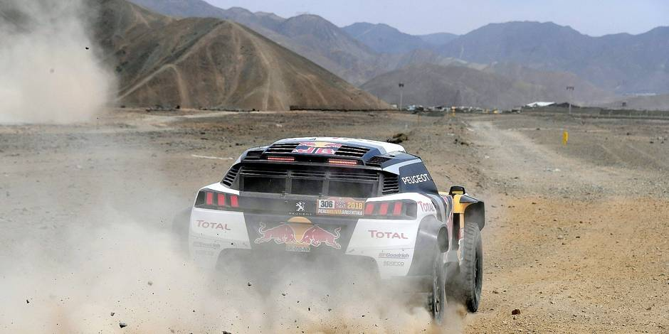 Peugeot's French driver Sebastien Loeb and co-driver Daniel Elena of France take part in a driving session, on the eve of technical checkup in San Bartolo 75 km south of Lima, on January 4, 2018, ahead of the 2018 Dakar Rally, which this year will thunder through Peru, Bolivia and Argentina from January 6 to 20. / AFP PHOTO / FRANCK FIFE