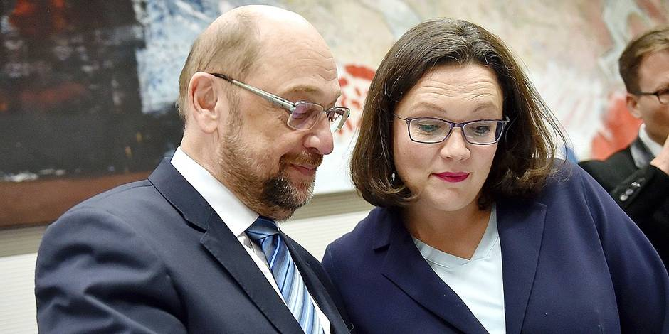 "Head of German Social Democratic party (SPD) Martin Schulz and SPD parliamentary group leader Andrea Nahles (R) talk before a parliamentary group meeting on February 7, 2018 in Berlin after the conservatives and the social democrats sealed a deal on a new coalition. German Chancellor hailed a hard-fought deal on a new ""grand coalition"" government which she said international partners had long been waiting for. / AFP PHOTO / Britta Pedersen"