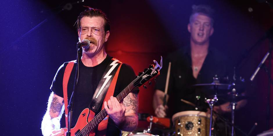 (FILES) This file photo taken on October 19, 2015 shows Musicians Jesse Hughes (L) and Josh Homme of Eagles of Death Metal performing at the Teragram Ballroom on October 19, 2015 in Los Angeles, California. The Eagles of Death Metal band, who were on stage of the Bataclan concert hall in Paris when gunmen launched their attack which killed 90 concertgoerson November 13, will perform on the stage of the Parisian music hall L'Olympia on February 16, 2015, according to producer Nous Productions on December 16, 2015. / AFP / GETTY IMAGES NORTH AMERICA / KEVIN WINTER